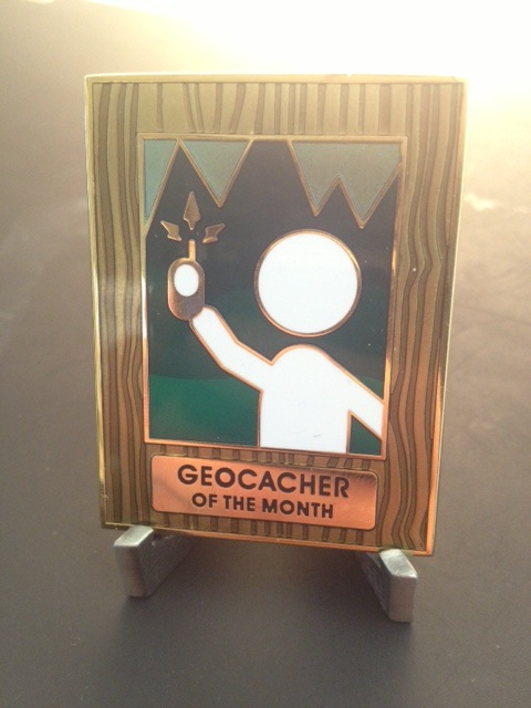 The earned, never for sale, Geocacher of the Month geocoin (sun flare optional)