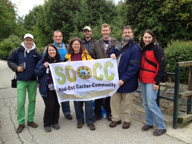 A group of geocachers attending the Mega-Event with a well-traveled banner (Eric is the third from the right)