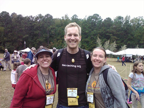 Geocaching HQ'er Sean with a couple of happy geocachers.