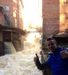 A happy geocacher by the white water. Photo by geocacher jetoma.
