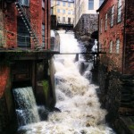 Whitewater running through a brick city.