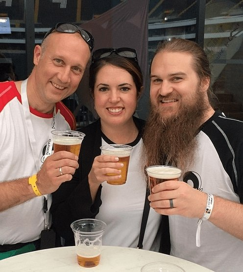 Nicolas, Laporca, takes a break from checking in on exhibitors and vendors to have a beer with Hailee and Justin.