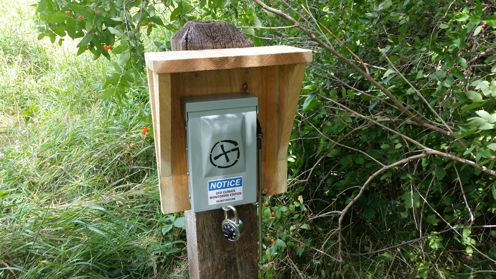 The geocache in the wild, attached, with permission, to a pole that was already there.