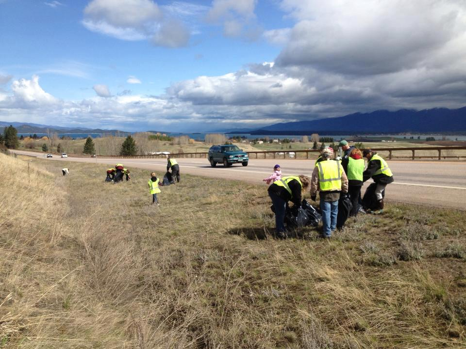 Geocachers in Montana cleaning the roadside.