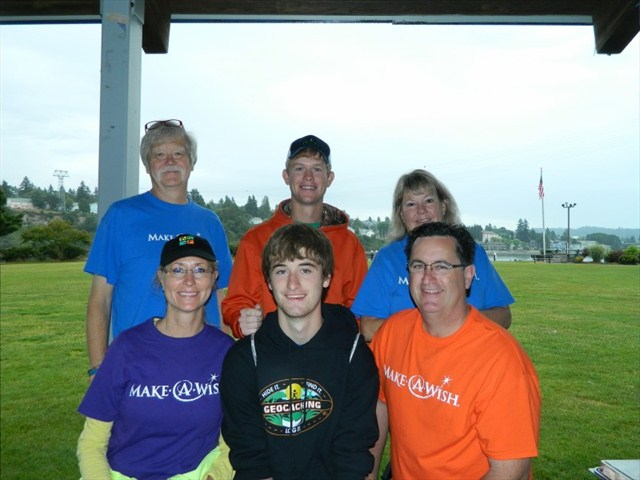 Jared (center) with his family and Make-A-Wish volunteers