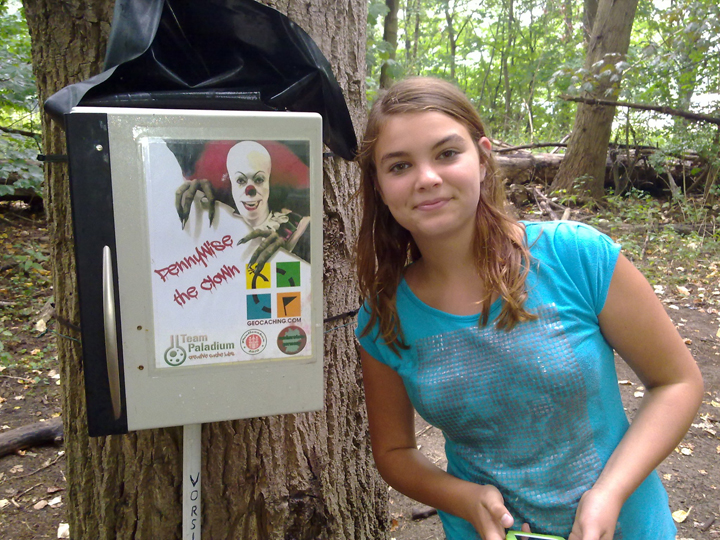 A brave geocacher next to the terrifying clown. Photo by geocacher -geosil-
