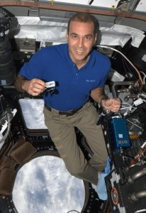 Astronaut Rick Mastracchio with the Geocaching Travel Bug  on board the ISS.