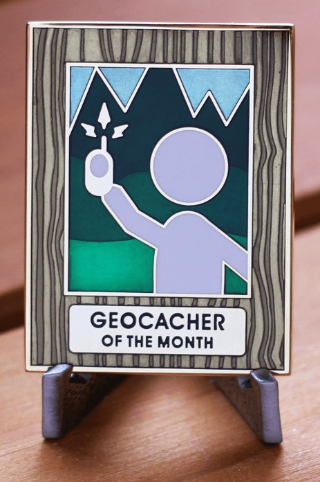 he earned, never for sale, Geocacher of the Month geocoin (sun flare optional)