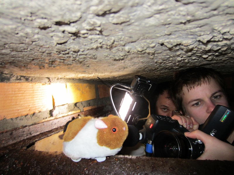 Crawling around in a cave. Anything for the shot!
