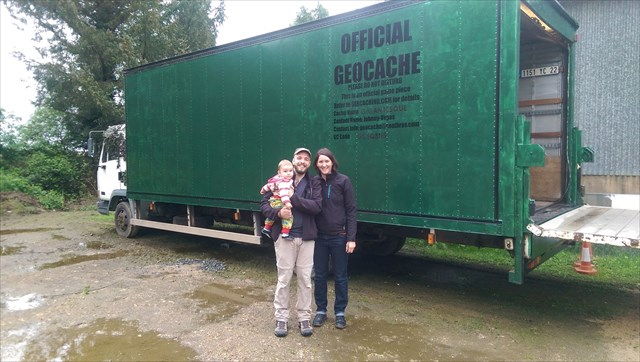 A happy family outside the container. Photo by Les moregans