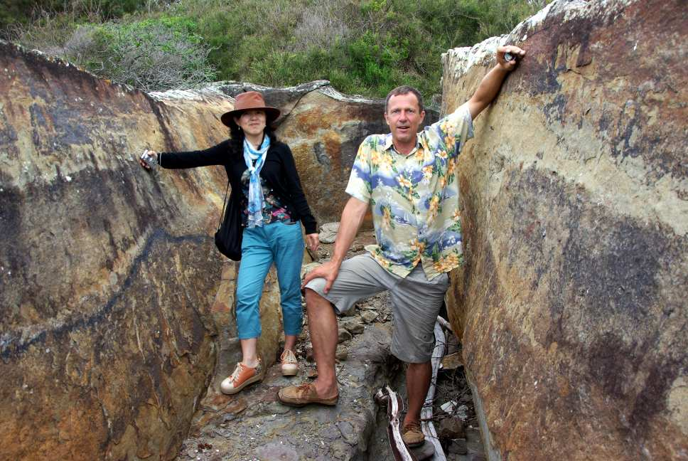 Geocachers sitting in a split joint. Photo by The Arkaroo.