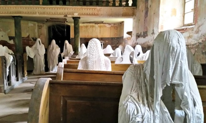 Over two dozen plaster figures are in the church