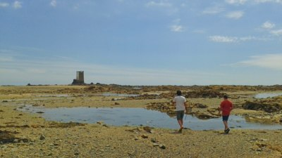 Walking to the cache at low tide